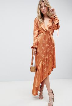 Wedding-guest dressing: it's a tricky one. You want to fit in with the formal vibe, but you also want to feel like yourself. So, like the groom's aunt loitering by the canapés, we're 100% here for you. From dresses to jumpsuits, here are 10 outfits to help you navigate that fine line between wedding-guest you and actual you.