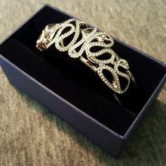 Authentic Swarovski Scribble cuff Large swarovski cuff adorned with hundreds of brilliant crystals.  Nib Swarovski Jewelry Bracelets
