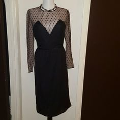 """Vintage dress made in Spain by Don Luis VINTAGE!!! Black dot mock wrap dress. Some mesh along zipper torn.The dots look brown black in person due to it's age.Armpit to armpit 17"""" and waist 14.5"""" hip 19.5"""" and 41"""" length from shoulder to hem.(Red belt not included!.) Statement style HP Vintage Dresses"""