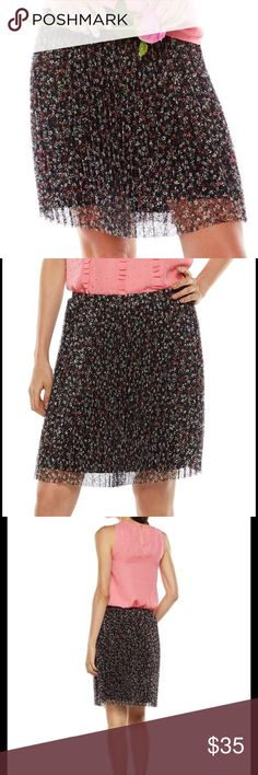 """ELLE Black Floral Lace Skirt NWT ELLE stunning feminine designed floral lace fully lined skirt will give you a romantic you'll wear with confidence!  Features a black background with pink, coral, white and yellow flowers.  The flowers look as if they were hand-painted!  *S (4-6), L (12-14), XL (16-18) *18 1/2"""" approximate length *Fully lined, elastic waistband *Skirt & Lining polyester, machine wash *Bundle Discounts * No Trades * Smoke free Elle Skirts Mini"""