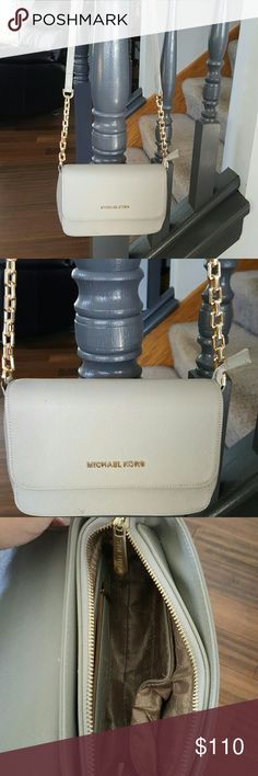 """Michael Kors Crossbody Purse I believe it's from the Bedford Collection. Silver with gold accents.  The only flaw is shown on the last picture barely noticeable.  Has zipper and magnetic snap closure . Measures approx 9"""" wide by 6"""" tall by 3"""" deep.  Big enough for a small wallet, phone and some other nessities.  Great for going out on the town. Michael Kors Bags Crossbody Bags"""