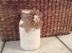Painted mason jar with old buttons as an accent