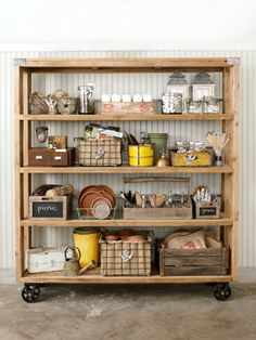 Garage turned into garden shed.    Use a tackle box to store all those little odds and ends— twist ties, nails, etc.—that tend to get lost.  A vintage dish drainer will hold all your flowerpot saucers.  Jute-lined bins mean you can toss a mix of stuff inside and no one can see your junk.  Use an old, small, wooden card catalog to store your seed packets and garden plans.