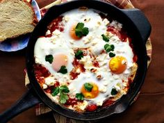 This shakshouka with feta is calling your name! Finished with poached runny eggs in a slow simmered tomato sauce.warm, healthy,and yummy! Low Carb Breakfast Easy, Gluten Free Recipes For Breakfast, Delicious Breakfast Recipes, Paleo Breakfast, Breakfast Casserole, Brunch Recipes, Delicious Food, Curry Recipes, Egg Recipes