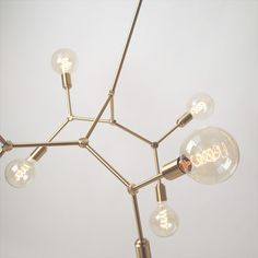 "The MOLECULE an elegant ""chandelier"" type light that is inspired by scientific molecular diagrams is now available for shipping. Lamp Design, Filament Bulb, Elegant Chandeliers, Bulb, Beautiful Lamp, Industrial Chandelier, Modern Lamp, Light, Chandelier"