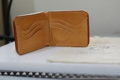 Surakan Leather   size:9*11.5 cm. material:leather(Cow leather)  This wallet is made of superior cow leather in original leather color and tan. There are 6 card slots,1 open slot for cash and 2 free slots.  This item is sent from Thailand Order Processing time  Please allow 3 to 5 days before shipping, as we dont carry a stock. all items need to make after order.