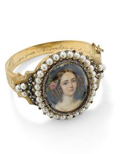 A 19th-century pearl and diamond double-sided portrait bangle