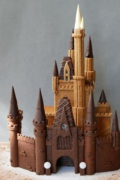 Cinderella's castle, made from about 240 pieces of gingerbread cookies, including a base recipe to help you build any other design you desire. Gingerbread Castle, Cool Gingerbread Houses, Gingerbread Dough, Gingerbread House Designs, Christmas Gingerbread House, Gingerbread Cookies, Christmas Cookies, Drink Bar, Cake Paris