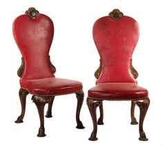 PAIR OF PARLOR CHAIRS - English Renaissance Revival Court Style Chairs in oxblood leather upholstery, brass tacking, the carved mahogany frame with crowned globe crest, cabriole legs terminating on carved hoof feet. Circa 1880