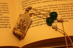 necklace miniature terrarium(the terrarium is made with a plug of a fragrance a transparent button and a bead )