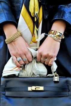 Accessories.  Also, I will buy my mother a bag like that one day, just because she deserves it.