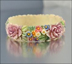 A gorgeous vintage hand carved vintage celluloid flower bangle bracelet. #vintage #jewelry #bracelets