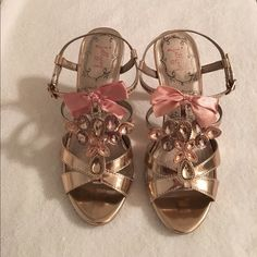 Jellypop Rose/Gold Sandals NIB Never worn! These shoes are incredibly adorable!!! Color is a rose/gold with jewels on the front. 3 in. heel. Size 7.5. jellypop Shoes Sandals
