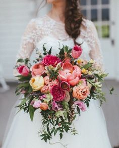 How beautiful is this floral bouquet. With cascading coral peonies, peach ranunculus and pink tulips, this floral bouquet is what we dream about for a summer wedding. Cascading Bridal Bouquets, Bride Bouquets, Bridal Flowers, Flower Bouquets, Pink Bouquet, Purple Bouquets, Peonies Bouquet, Bridesmaid Bouquets, Brooch Bouquets