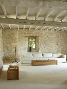 stone walls and whitewashed ceilings with modest beams