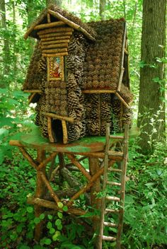 Here, a fairy house made of pine cones and twigs.