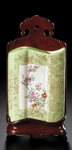 A FAMILLE-ROSE LIME-GREEN GROUND SCROLL-SHAPED WALL VASE<br>QING DYNASTY, 18TH CENTURY | Lot | Sotheby's