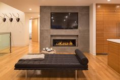 A gas fireplace warms the living room of the remodeled San Mateo home. Photo: Marcell Puzsar/Vanguard Properties