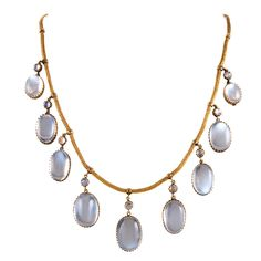 Victorian Moonstone Gold Festoon Necklace   From a unique collection of vintage drop necklaces at https://www.1stdibs.com/jewelry/necklaces/drop-necklaces/