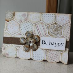 handcrafted greeting card from Susanne Blog: Mosaic (Danish blogger so Google translated for me)  ... hexagon tiles  in pale neutral colors ... looks like they were whitewashed ... paper was scraps ... some made to match the scraps ... like the natural color ... flower made of sheet music and has been waxed ... like this card ...