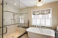 Amazing Bathroom Design Curtains For Window With Wall Tiles And Modern Lighting Above Bath