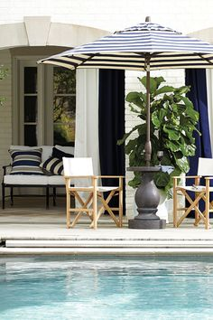 Ballard Designs and Domino design a poolside summer party umbrella holder & chairs - inspiraiton