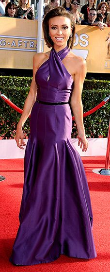 Giuliana Rancic: 2014 SAG Awards  The E! News host wore a satin purple gown with a cross halter neck that included a keyhole slit that showed a sliver of cleavage. She added a black belt to her gown and left her short tresses down in a swept-back bob hairstyle.  Read more: http://www.usmagazine.com/red-carpet/giuliana-rancic-2014-sag-awards-2014181#ixzz2qrRfwhF2