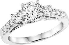 Brilliant cut 3 stone diamond engagement ring