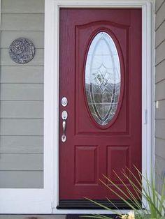 Grey siding, white trim, red (burgundy?) front door