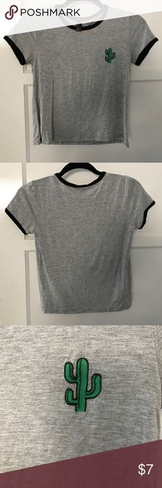 (BNWOT) Super soft tee with cactus Grey with black trim on the collar and arms, super soft stretchy material and a cute green embroidered cactus in the left upper chest area. Brand new, never worn Forever 21 Tops Tees - Short Sleeve