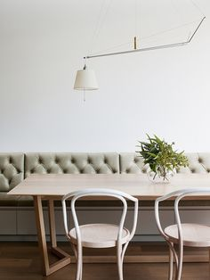 tufted bench seating and bentwood chairs