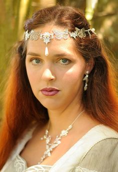 Elven bridal circlet with silver-plated butterflies connected to crystal links, accented with pearl drops and graduated lengths of silver-plated chain draping the back of the hair. Magical, delicate, perfect for Renaissance, Medieval, Fantasy or Elven wedding, cosplay and fair wear. Adjustable, will fit most adult heads. Not appropriate for childrens wear.  (This listing is for the crown only. Necklace and earrings are not for sale.)