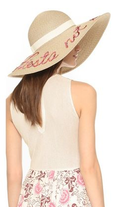 Sequined 'Fiesta not siesta!' lettering adds a playful touch to this floppy Eugenia Kim hat. Grosgrain band.