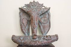 """A fascinating depiction of Lord Ganesha just right enough to lend that touch of exclusivity to your art collection!  Product id - SC02 Product Description - A """"Ganesha"""" statuette in Lost wax, Bronze, Size - 12in * 10.5in * 4.5in Artist - Somnath Chakraborty  For enquiries, call or whatsapp to +91 9007798937."""