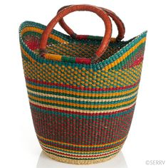 Bolga Boat Bag | Bright colors, leather-wrapped handles, and a boat-shaped design lend this elephant grass basket its distinctly African flair. Roomy construction provides easy access to farmers market produce or everyday storage. serrv.org