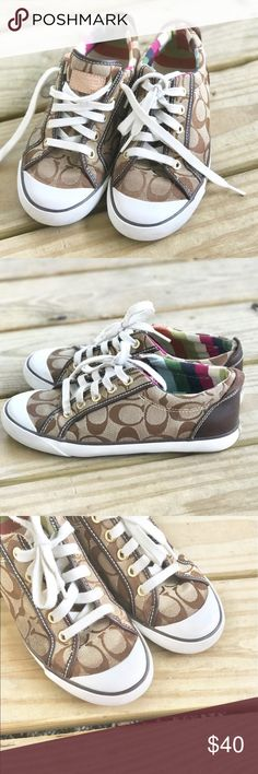 8ff9aa8ec Lace up Coach sneakers dressed in its signature logo! Gently used condition  with minimal signs of wear!