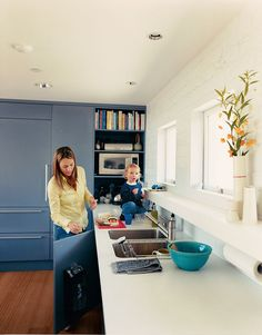 Julie enjoys her new kitchen with son Emerson.