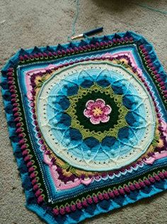 "Pattern is: Sophie's Garden Mandala (Squared) - Using Lilypond Blanket CAL Yarn (colors) The pattern is called Sophie's Universe (or Garden) by Dedri Uys - her webpage is Lookatwhatimade.net... (just google ""Sophie's Universe"" or Sophie's Garden"" to find the pattern)"