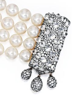Detail: Gold, blackened silver, diamond and pearl bracelet by JAR, Paris. The 4-strand bracelet features 68 cultured pearls. The blackened silver clasp is reverse-set with 30 round diamonds (approximately 9.00 carats) and pavé-set with numerous single-cut diamonds. Via Diamonds in the Library.