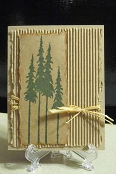 handmade card ... kraft ...  simple rustic pines by lori92760 ... corrugated and torn edged background ... natural raffia wrap ... tall and skinny pines stamped on torn edged rectangle ... luv the country look ..