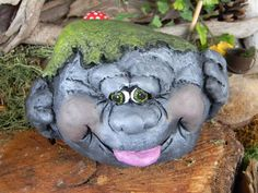 Kid Rock, the grinning like a possum garden statue... Moss Rock. $15.00, via Etsy.