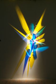 Artist Stephen Knapp creates his technicolor masterpieces with a remarkably ordinary, if impalpable, material: light, manipulated into radiant bursts with the help of glass and stainless steel.