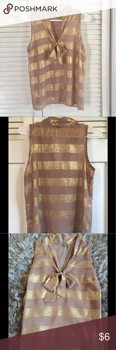 Charlotte Russe Gold Tie Tank Blouse This medium sheer tank from Charlotte Russe has a front tie and metallic gold stripes. Soft and silky. No stains or holes. Size medium. Charlotte Russe Tops Tank Tops