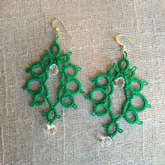 "TAILOR & FLAIR Handmade lace earrings New (tatting) lace earrings. Bright green with imitation crystal drop beads. 3"" long. Light weight. Perfect statement piece for a simple outfit. Delicate and intricate details and design. Handmade in Perú. 🇵🇪 20% off bundle! 💡https://www.facebook.com/tailorandflair/ Tailor and Flair Jewelry Earrings"