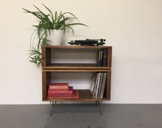 This is a low version of our classic industrial rustic style TV console, media unit or coffee table. It is made from a high quality rustic softwood, sanded to a beautifully smooth finish, stained and treated with a hard wearing oil finish and wax. It is sat on 20cm high Eames style hairpin legs and measures 34cm (14) in total height. It has a full width, 9.5cm (3.7) high opening that is accessible from either side of the table, ideal for housing coffee table paraphenalia or a DVD player, Sky…