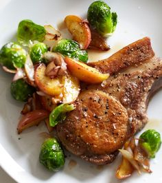Pork Chops with Roasted Apple, Brussels Sprouts and Bacon | Here, Brussels sprouts are glazed with apple cider and served alongside pork chops.