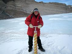 NASA researcher Margarita Marinova drills a core from the ice pack at the head of University Valley in the McMurdo Dry Valleys. The ice core will be analyzed for composition of the ice and the air bubbles, which may provide information on the age of the snow pack in the valley. Since snow packs don't flow like glaciers, it is possible that the snow pack is quite old. Old ice is a great window into the climatic history of the area. Marinova is a member of Jen Heldmann and Chris McKay's NASA… Ice Pack, Antarctica, Photo Library, Winter Jackets, Drills, Margarita, Nasa, Flow, Composition