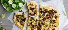 One bite of this vegan flatbread pizza and you'll feel transported to the Aegean Sea. It's bursting with flavorful favorites, like sun-dried tomatoes, homemade hummus, black olives, and tender artichoke hearts. Cook it over a steel pan or pizza stone while it preheats for extra crisp.
