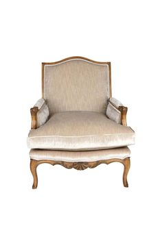 The Dove Bergère in Louis XV style is shown in Cherry wood with a Honeycomb finish. It has stylized scallop shell hand-carvings to its wooden frame and a loose seat cushion.