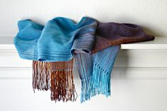 """Hand woven scarfin blue and brown colors. Perfect #gift idea! This woven scarf is very soft and drapes perfectly! Measures: L: 78"""" with 6"""" fringe on both ends W: 11"""" Care i... #kgthreads #accessories #cozy #fall #fashion #gradient #turquoise #unisex #women #wrap"""